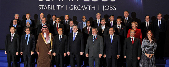 Summit host British Prime Minister Gordon Brown, front row center, stands with the other G20 leaders during the group photo Thursday.