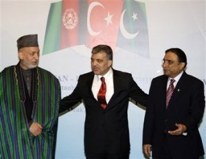 From left, Afghanistan President Hamid Karzai, his counterparts Abdullah Gul of Turkey and Asif Ali Zardari of Pakistan are seen during a news conference after talks in Istanbul, Turkey, Monday, Jan. 25, 2010.