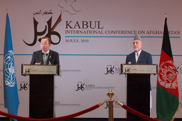 Presidnet Hamid Karzai takes a question during a joint news conference with Secretary-General Ban Ki-moon after the Kabul International Conference in Kabul